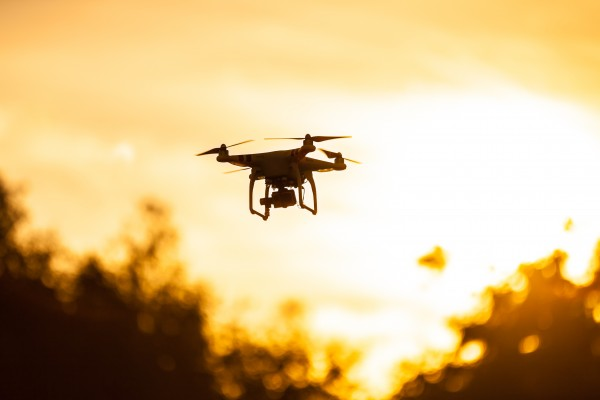 Photo of a quadrocopter on sunset sky
